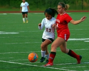 Druid Hills Stella Shardan (14) battles with Southeast Whitfield's Yeyetzi Perez during the first round playoff game at Adams Stadium. (Photo by Mark Brock)