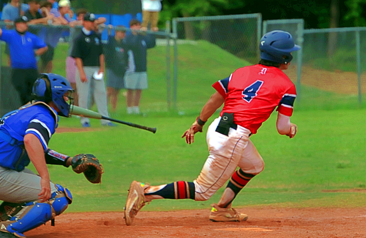 Dunwoody's Nathan Pettitt (4) heads to first base on a hit into left field during the Wildcats' playoff loss to South Forsyth. (Photo by Mark Brock)