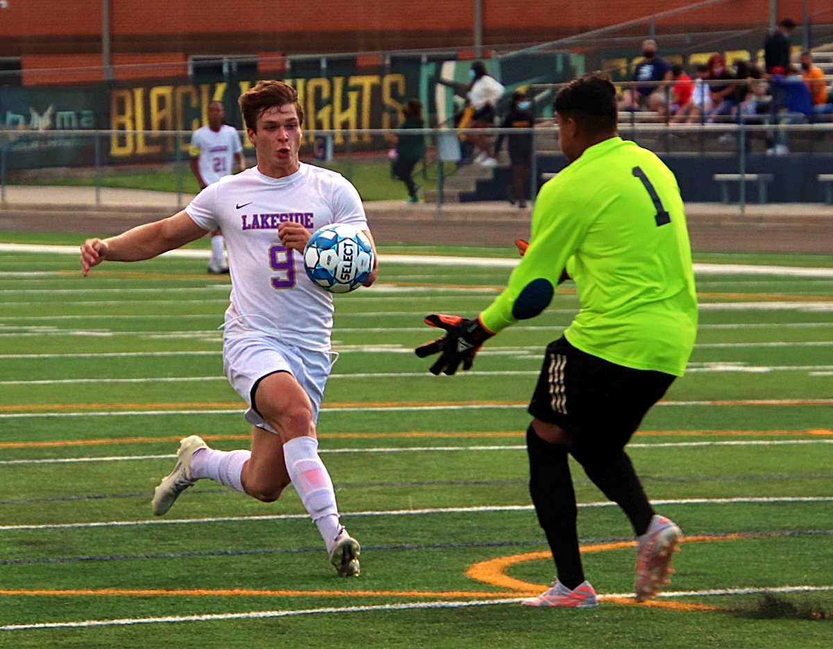 Lakeside's Zach Martin (9) going after ball in front of Central Gwinnett's keeper scored two goals in the game to lead the Vikings to a 3-1 Class 6A state playoffs victory. (Photo by Mark Brock)