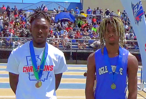 Quandarius Patrick (left), a senior at Towers High School, exchanged medals with Oglethorpe County sophomore Michael Fleming as ruling caused a re-running of the 110-meter hurdles at the Class 2A State Meet. (Photo courtesy of GA Milesplit)