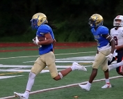 Chamblee's Sydyk Ross crosses the goal line on a 15-yard fumble return for a touchdown. It was the first of two defensive scores by the Bulldog who also returned an interception 35 yards. (Photo by Mark Brock)
