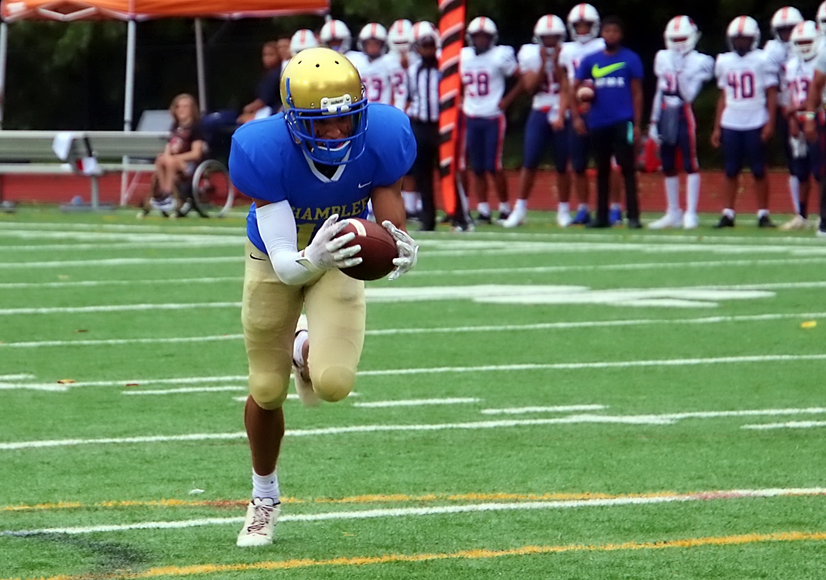 Chamblee's Connor Pressnall scoops up a blocked punt and returns it 10 yards for a touchdown against North Springs in the Bulldogs' 59-21 victory on Thursday at North DeKalb Stadium. (Photo by Mark Brock)