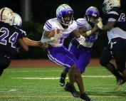 Miller Grove's Jayden Brown (1) cuts behind a teammate's block as Lakeside defender Ross Wilson (24) and a teammate try to hem him in during Miller Grove's 47-0 win. (Photo by Mark Brock)