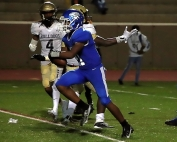 Stephenson running back Cheik Kita (21) slips into the end zone untouched for the game clinching touchdown with just over two minutes to play. (Photo by Mark Brock)