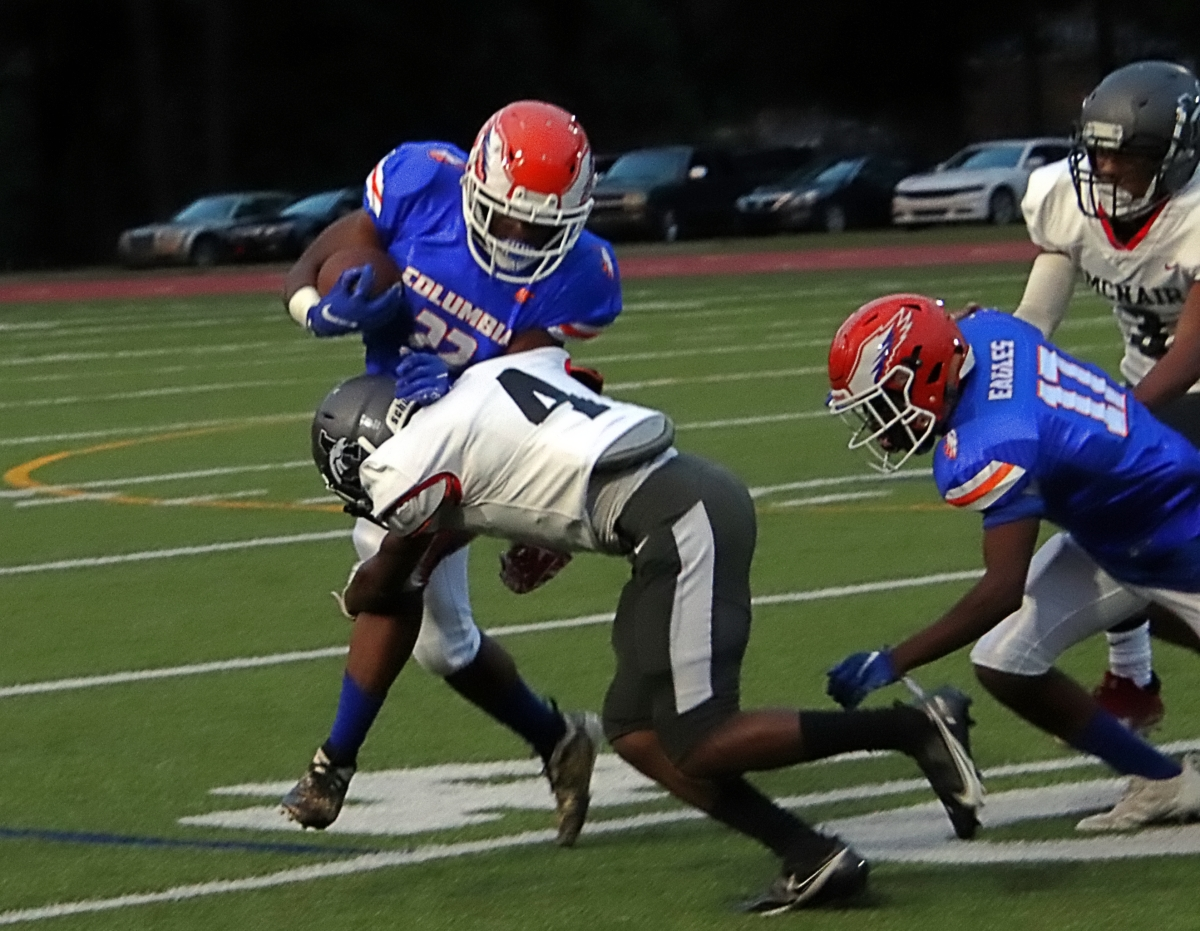 McNair's Sederian Williams (4) goes low to tackle Columbia's Laquavious Oliver during first half action of Columbia's win. (Photo by Mark Brock)