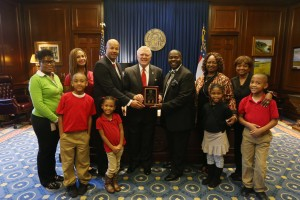 red ribbon with governor nathan-deal