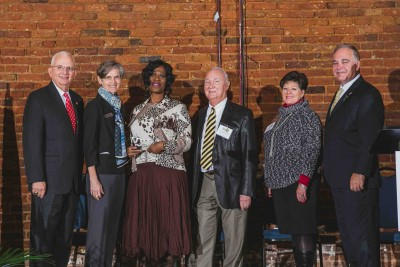 Joyce Wimberly (3rd from left), Executive Director of DCSD School Nutrition, accepts Golden Radish Award.