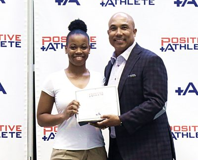 Azhana Maxwell holds certificate with Hines Ward