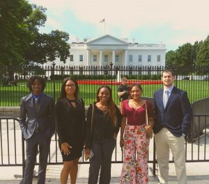 five redan students stand in front of white house