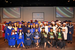 summer graduates pose with board member