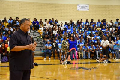 Jesse Jackson speaks with Cedar Grove High students in gym