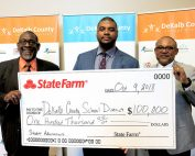 DCSD and State Farm leaders hold check