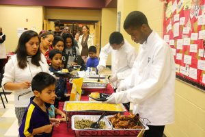 culinary student shares food to boy