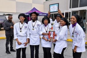 miller grove students hold 1st place trophy