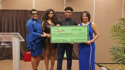 Washington holds large scholarship check