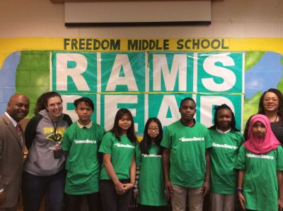 students stand in front of Rams Read sign