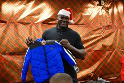 Shaq holds up jacket