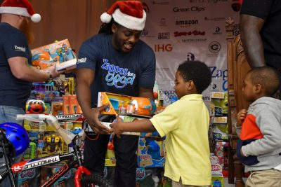 boy receives toys from man