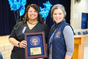 regional superintendent and principal smile with plaque