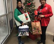 teachers hold lend a hand gifts