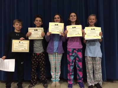 austin essay winners hold certificates