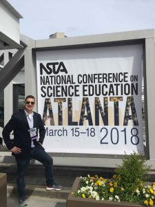 Brian Gardiner stands in front of NSTA sign
