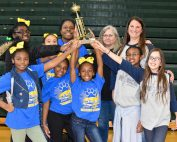 chapel hill and oak grove winners hold trophy