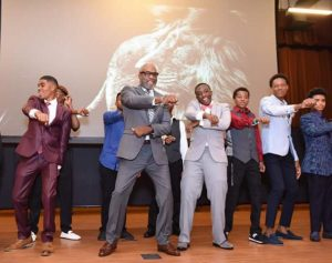 male students dance on stage