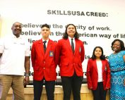 SkillsUSA students stand with blazers