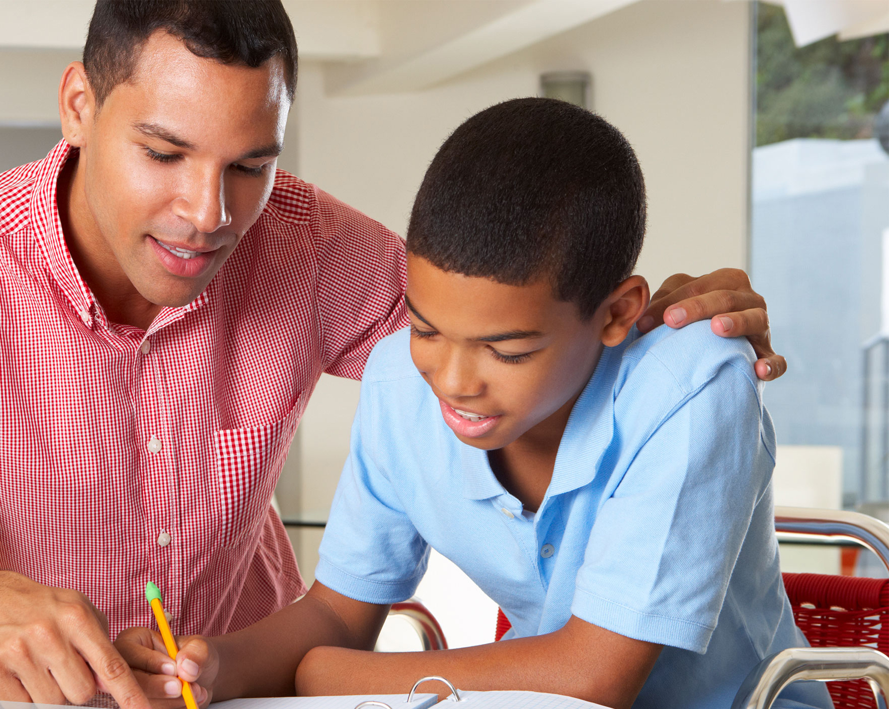 Transition Fair thumb image. Father helping son with school work.